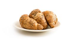 Tre croissant su un piatto bianchiccio Fotografia Stock