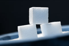 Tre cubi dello zucchero fotografia stock