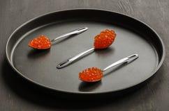 Tre cucchiai con il caviale rosso Fotografia Stock Libera da Diritti