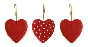 Tre cuori di legno rossi Immagini Stock Libere da Diritti