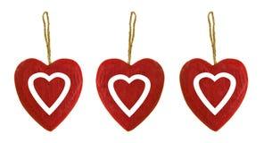 Tre cuori di legno rossi Fotografie Stock Libere da Diritti