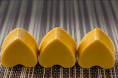 Tre cuori gialli del sapone Fotografia Stock Libera da Diritti