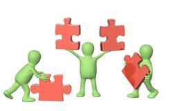 Tre 3d equipaggiano con i puzzle Fotografia Stock Libera da Diritti