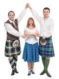 Tre dansare i kläder för skotsk dans Royaltyfri Fotografi