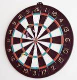 Tre dardi nel dartboard Immagine Stock