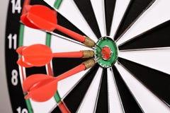 Tre dardi rossi nel centro dell'obiettivo Immagine Stock Libera da Diritti