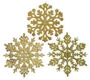 Tre decorazioni di forma del fiocco di neve dell'oro isolate su bianco Immagini Stock Libere da Diritti