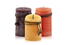 Tre dekorativa stearinljus Arkivbilder