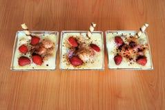 Tre dessert del pudding Immagini Stock Libere da Diritti