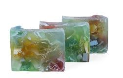 Tre di pezzi colorati multi di sapone fatto a mano isolati su fondo bianco Fotografie Stock