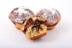 Tre di recente muffin al forno saporiti Fotografia Stock