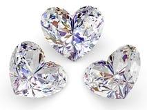 Tre diamanti sotto forma di cuore su bianco Fotografie Stock Libere da Diritti