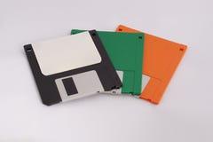 Tre disketter på vit bakgrund arkivbild