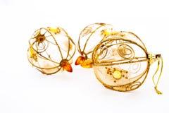 Tre dolda guld- julgrangarneringar för tråd Royaltyfri Foto