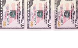 Tre 50 dollar sedlar som isoleras på vit bakgrund Arkivbilder