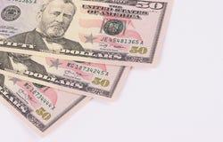 Tre 50 dollar sedlar som isoleras på vit bakgrund Arkivbild
