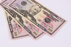 Tre 50 dollar sedlar som isoleras på vit bakgrund Arkivfoto