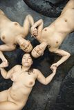 Tre donne nude. Fotografie Stock