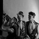 Tre esecutori di circo su fondo bianco Fotografie Stock Libere da Diritti