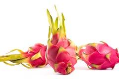 Tre exotiska rosa drakefrukter Royaltyfri Bild
