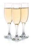 Tre exponeringsglas av champagne   Arkivfoton