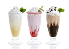 Tre exponeringsglas av milkshakar royaltyfri bild
