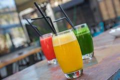 Tre exponeringsglas av smoothiefruktsaft Royaltyfria Foton