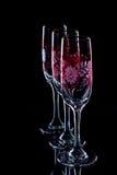 Tre exponeringsglas med den röda prydnaden Royaltyfri Foto