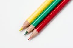 Tre färgade blyertspennor Royaltyfri Bild