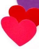Tre färgade hjärtaformer Arkivfoton