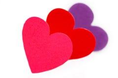 Tre färgade hjärtaformer Royaltyfri Foto