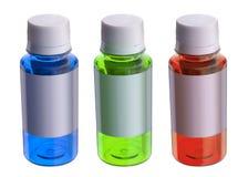 Tre färgflaskor Royaltyfri Bild