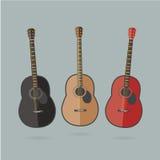 Tre färgrika akustiska gitarrer i en plan tecknad film utformar Arkivfoto