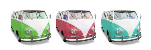 Tre färgrika VW-campareskåpbilar arkivbilder