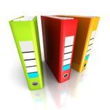 Tre färgrikt kontor Ring Binders On White Background Arkivbilder