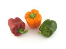 Tre färgspanska peppar som tätt isoleras upp Royaltyfri Fotografi