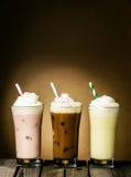 Tre förnyande krämiga milkshakar arkivfoton
