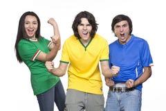 Tre fans av fotbollen royaltyfria foton