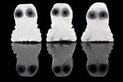 Tre fantasmi bianchi sul nero Fotografia Stock Libera da Diritti