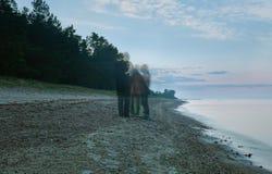Tre fantomer meddelar peacefully ashore Royaltyfri Foto