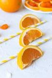 Tre fette arancio su un fondo strutturale Immagini Stock Libere da Diritti
