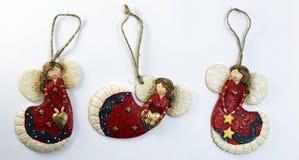 Tre figurine di angelo della ceramica Fotografia Stock