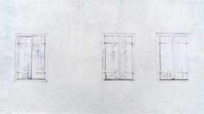 Tre finestre con gli otturatori chiusi Fotografia Stock Libera da Diritti