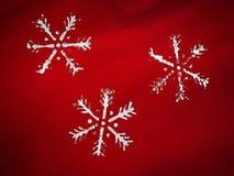 Tre fiocchi di neve Fotografia Stock