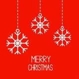 Tre fiocchi di neve d'attaccatura. Carta di Buon Natale. Fotografie Stock Libere da Diritti