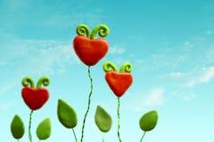 Tre fiori del cuore Fotografie Stock