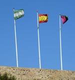 Tre flaggor i Malaga Spanien Fotografering för Bildbyråer