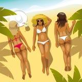 Tre flickor på stranden Arkivfoto