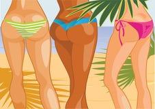 Tre flickor på stranden Royaltyfria Foton