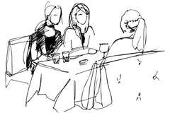 Tre flickor på en tabell i ett kafé Royaltyfri Bild